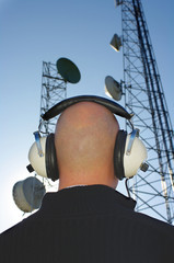 Bald man with headphones and antenna