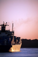 cargo ship freighter in sunset