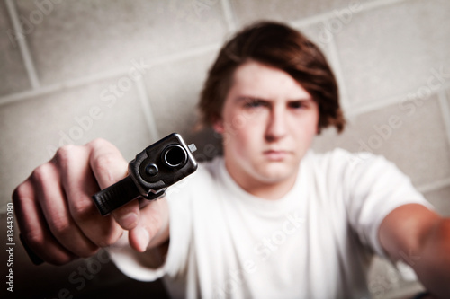 teen male with gun