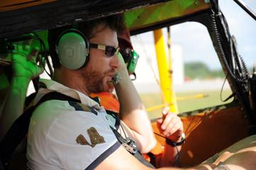 Two pilots testing the radio
