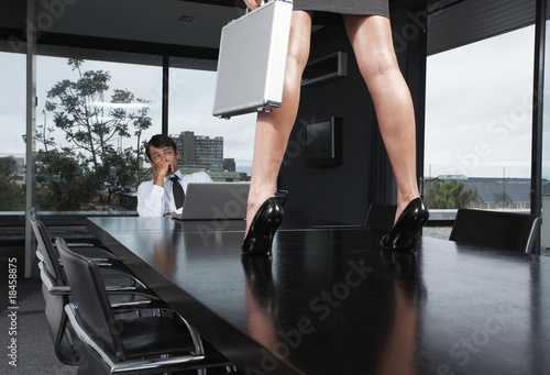 Businessman looking at woman's legs