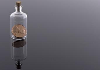 One penny in corked bottle