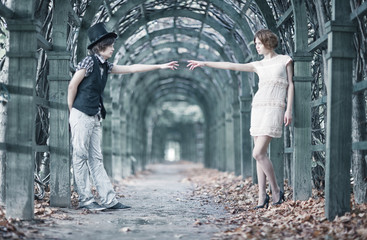 Young couple in a park stretching hands.