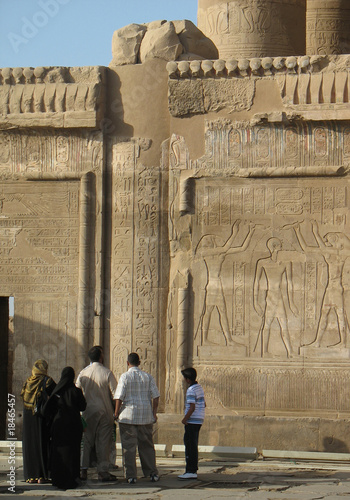 Egyptian hieroglyphic and tourists