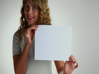 A woman holding a paper