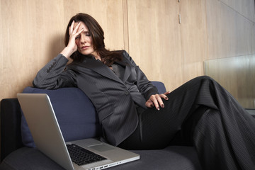 Business woman sleeping on a sofa