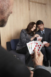 Businesspeople playing poker