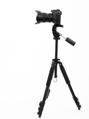 silhouette of professional digital photo camera on a tripod