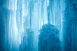 Leinwanddruck Bild - A frozen waterfall with ice in a blue and white color in winter