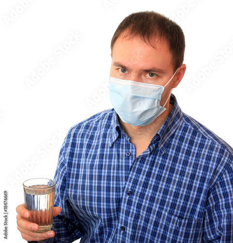 Man in a medical mask with water.