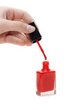 Hand with tassel and red varnish for nail poster