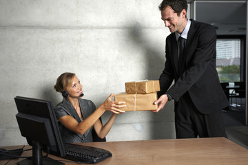 Secretary accepting a package