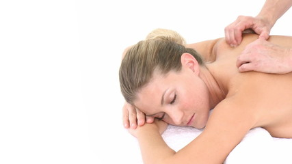 Attractive Woman lying on massage table at spa