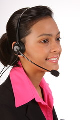 Customer support by beautiful young woman on telephone