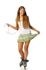 Girl with earphones in rollerskates on a white background.