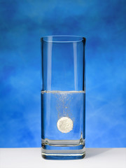 Aspirin tablet sparkling in a glass 02