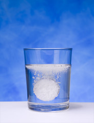 Aspirin tablet sparkling in a glass 04