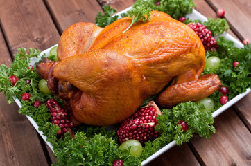 roasted chicken garnished with parsley and fruits