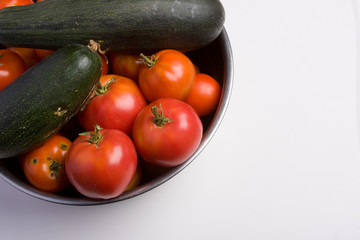 A bunch of Tomatoes and zucchini
