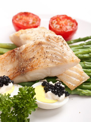 healthy fish with asparagus, tomatoes and caviar