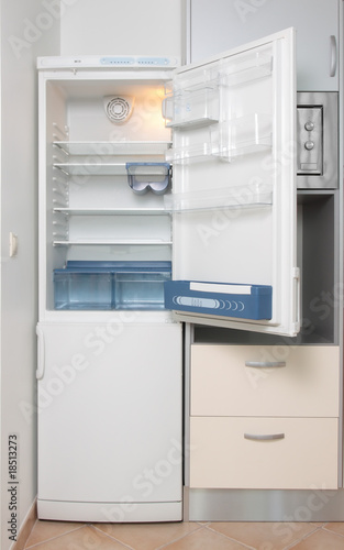 kitchen with a open refrigerator