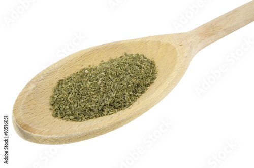 parsley herb on wooden spoon isolated on white background