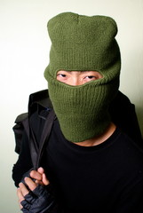 Smiling cat burglar with balaclava mask