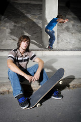 Skateboarders in underground parking lot