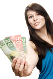 Young woman holding canadian currency