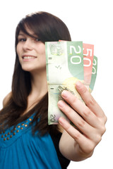 Young woman holding currency