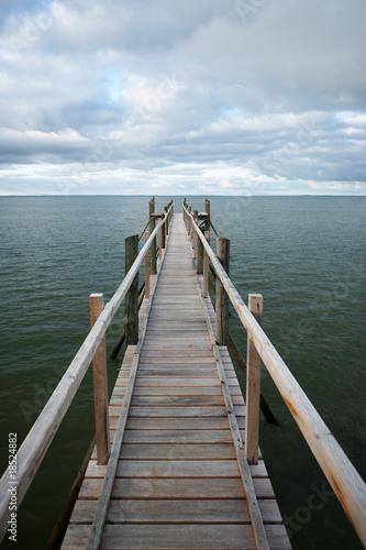 Footbridge under moody sky - 18524882
