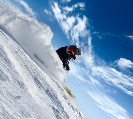 skier rush in clouds of snow powder
