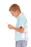 A young boy is furiously screaming into his cell phone. poster