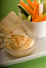 hummus dip with pita brad and vegetable