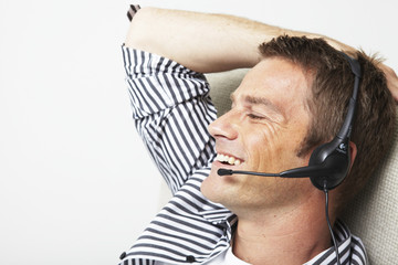 Smiling man with a headset