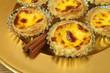 Pasteis de nata - egg tarts on golden plate