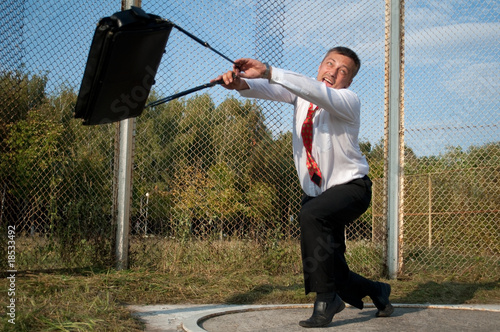 Businessman throwing briefcase