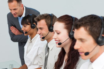 Manager talking to his team in a call center
