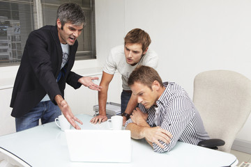 Businessmen discussing a project