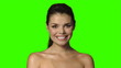 Beautiful and sexy woman is smiling on green screen