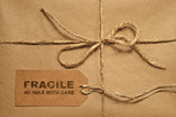 Brown shipping parcel tied with twine and tag for copy space poster