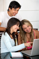 Students with a computer