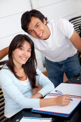 Couple of students at home