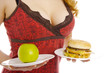 Photo of the woman with an apple and hamburger.