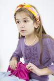 little cute girl open her beg poster