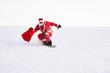 Santa unterwegs mit Snowboard