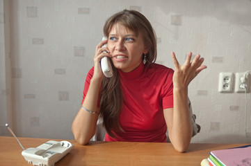 The woman speaks on the phone