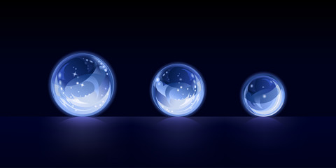 Crystal balls on dark blue background