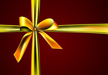 Geschenk mit einer goldenen Schleife