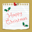 """""""Happy Christmas"""" note stuck on notice board with holly motif"""